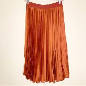 H&M pleated satin burnt orange skirt